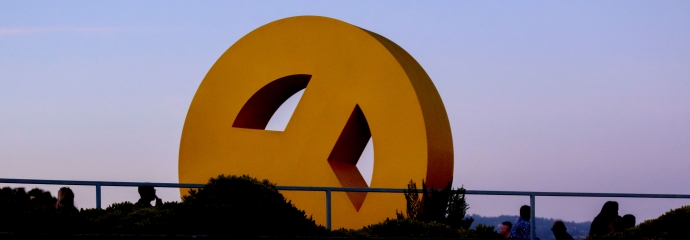 Skyline of the Oakland Museum of California with Peace Sign sculpture by Tony Labat