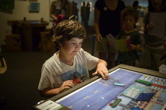 A boy plays with an animation maker screen